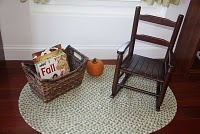 Simple reading rug space with rocking chair and basket of books...this will be perfect for MB's rocking chair!