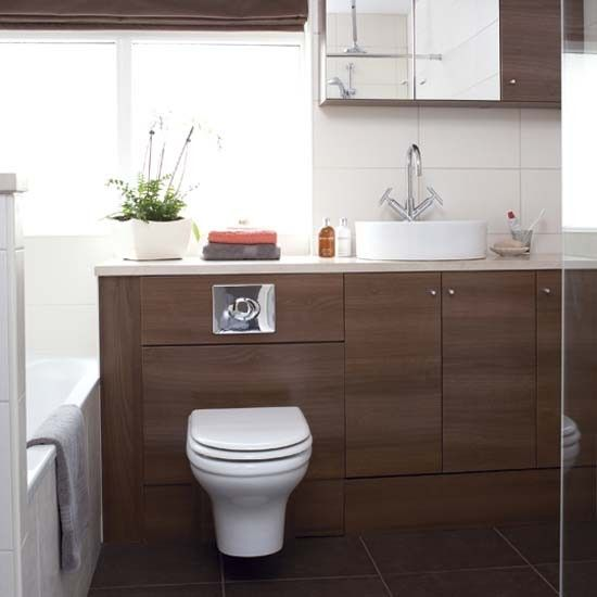Sleek and chic made to measure storage units make the most of the space in this white and brown bathroom  The brown units add definition to the white tiled. 78 Best images about Bathroom Ideas on Pinterest   Small bathroom