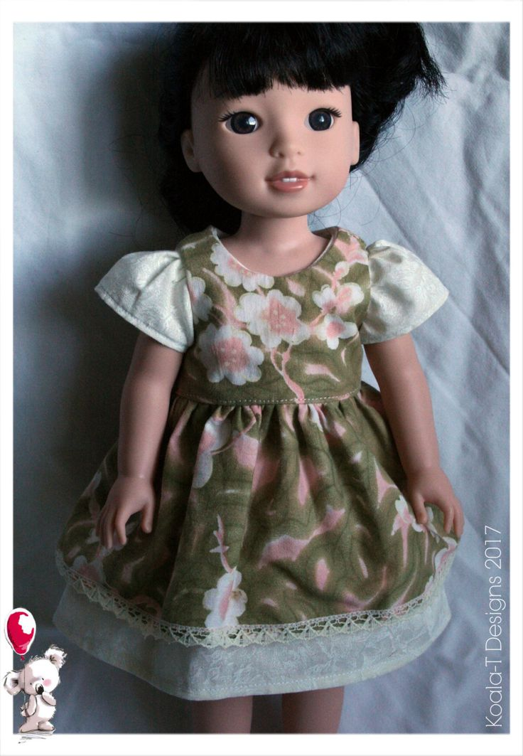 A beautiful cream, puff sleeved dress. Comes with a matching pinafore dress in pastel neutral tones & lace.  Hand sewn, using 100% pre-washed cotton fabric. Pattern by Oh Sew Kat - SugarnSpice. In our smoke-free dog friendly homes.  Made to fit 14 dolls like: Wellie Wishers Hearts for Hearts