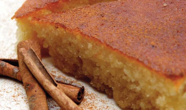 Greek #ravani - A moist and delicious semolina cake flavored with a touch of lemon and sweetened with a simple syrup flavored with orange zest.