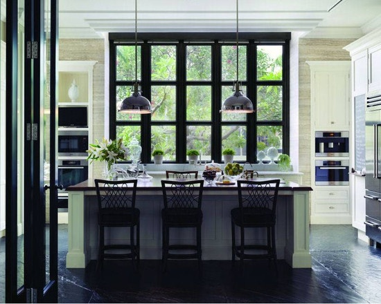 Love the black bifold doors and the gorgeous windows.