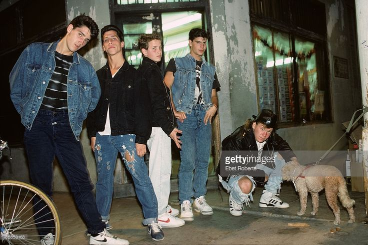 Photo of NEW KIDS ON THE BLOCK and Jordan KNIGHT and Joey McINTYRE and Danny WOOD and Donnie WAHLBERG and Jonathan KNIGHT; Posed group portrait L-R Jonathan Knight, Danny Wood, Joey McIntyre, Jordan Knight and Donnie Wahlberg, plyaing with pet dog