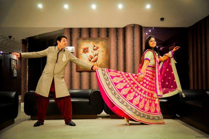 Indian wedding photography. Couple photo shoot ideas. Candid photography. Indian bride wearing bridal lehenga and jewelry. #BridalHairstyle #BridalMakeup