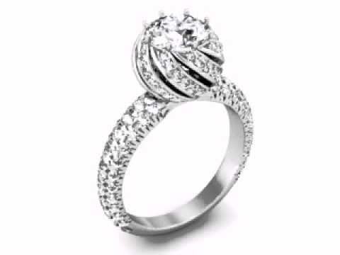 Custom Diamond Rings   Custom Engagement Rings   Custom Rings   Dallas Diamonds.  Halo Engagement Rings in Dallas, Texas.  http://www.diamorediamonds.com/