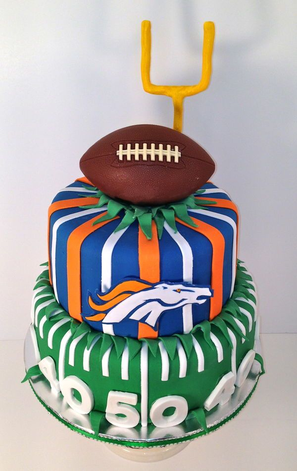 Football Wedding Cake: This NFL wedding cake for the Denver Broncos makes sure to include both the team logo as well as the bright team colors of orange and blue within the fondant design. | 10 Sports-Themed Groom's Cakes for Football Fans