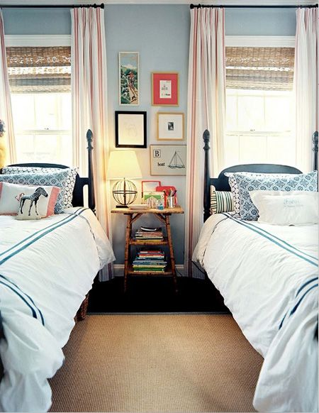 black beds, blue walls, bamboo blinds, striped curtains, reddish accent.