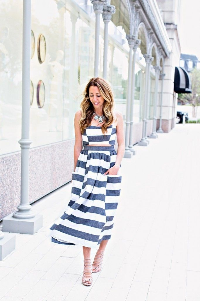 The Motherchic wearing striped cutout midi dress by mara hoffman