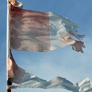 Ripped faded Candian flag.  Brian Kennedy/Getty Images