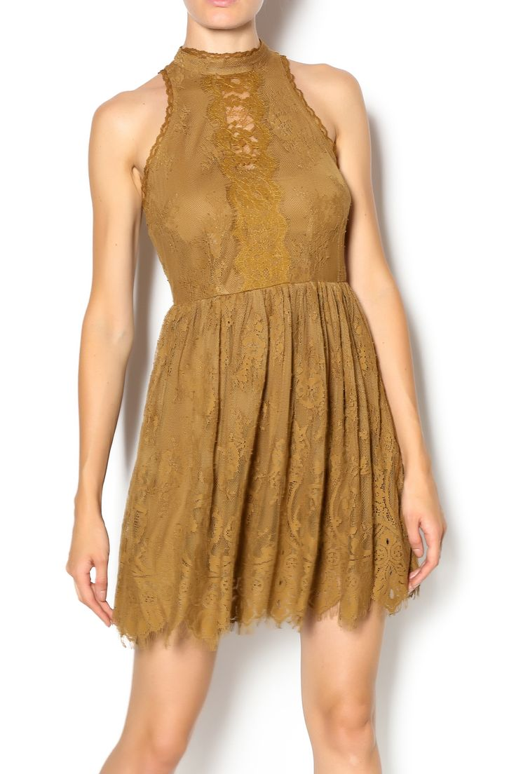 Amber gold A-line lace dress with high neckline and matching lining. Two buttons at the back of the neck, three buttons down the center creating four diamond shaped openings.   Golden Lace Dress by Free People. Clothing - Dresses - Mini Clothing - Dresses - Cocktail Kansas