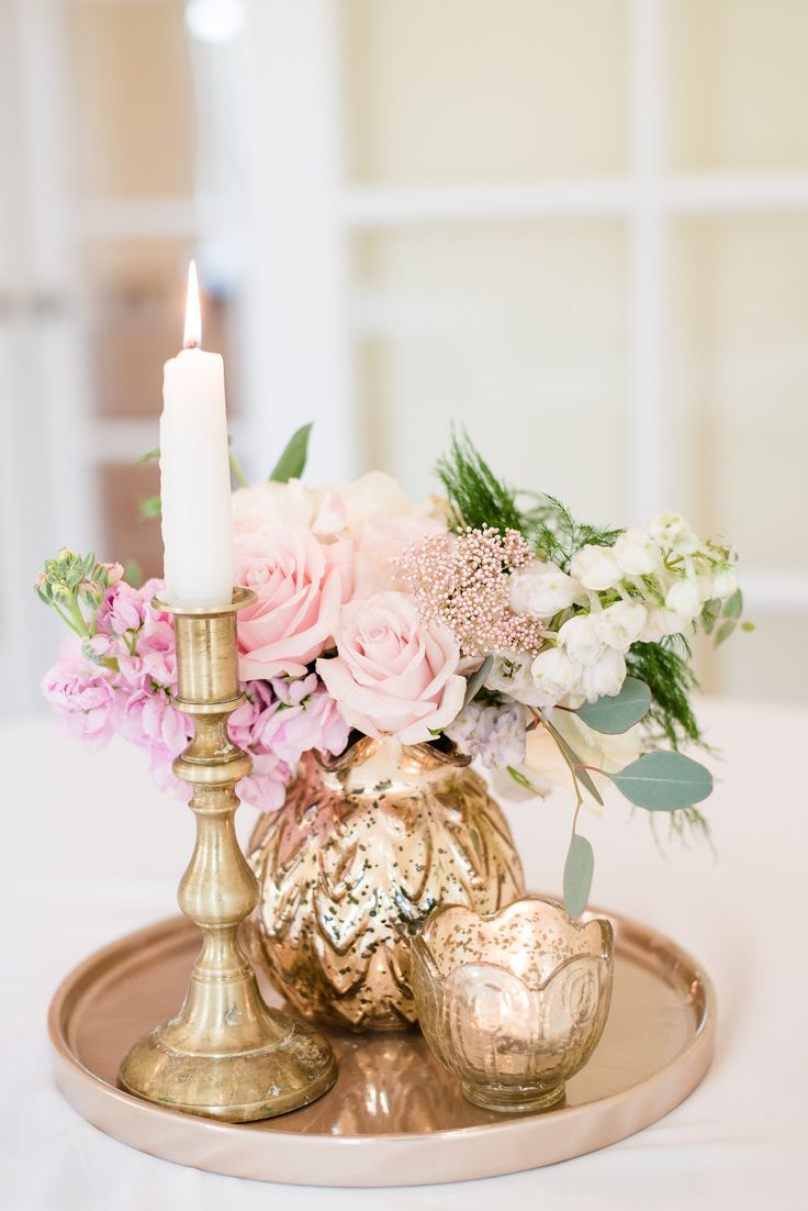 Romantic centerpieces, indoor wedding reception, pink roses, shabby-chic vases, white candles // Eric & Jamie Photography