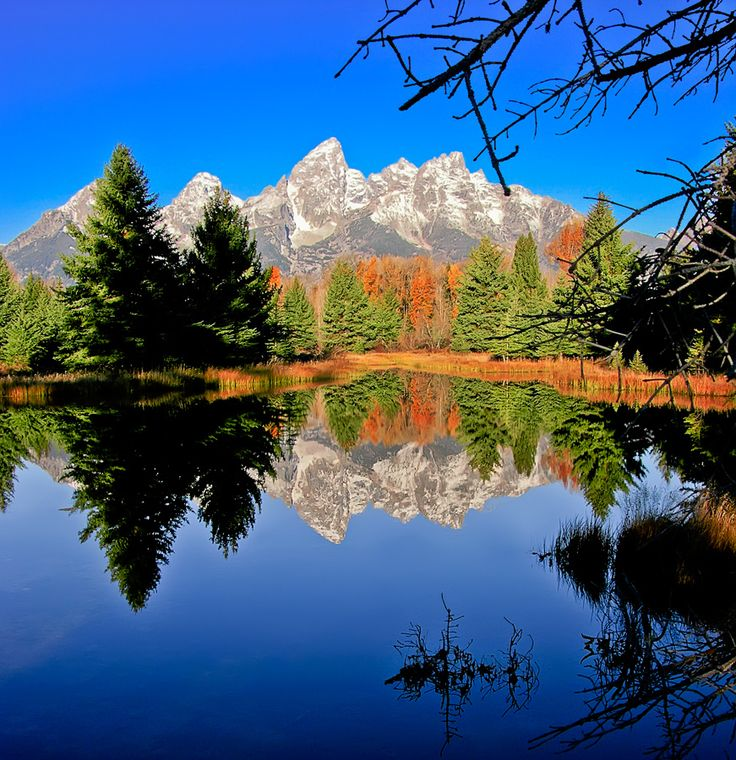 Jackson Hole, WY  The Grand Tetons really look like this. It is breath taking. I think we have this same pic.