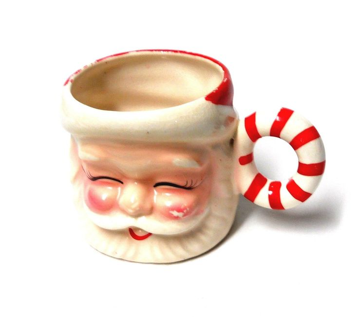 Vintage Santa Claus Figurine Mug With Candy Cane Handle. Only has a number on the bottom. Number 561/4. Not dated. From the 1950's. Came from Mom and Dad's and is being stored with Christmas items.