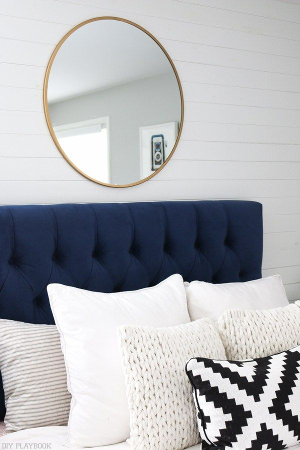 We finally found a mirror to hang above our headboard... and we LOVE the new (and inexpensive) look!