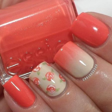 ombre nails decorated with flowers in coral