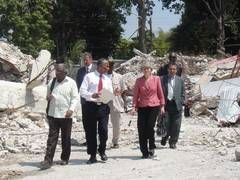 In the aftermath of the 2010 Haiti earthquake, UNESCO created a crisis team that worked to prevent the looting of the country's precious artifacts and heritage. Here, UNESCO Director General Irina Bokova tours the country after the destruction.