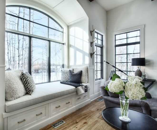 Arched Window Seat Great Room With Built In Day Bed Featuring A Barrel Arch And Wainscoting Throughout A Veranda Interiors Living Room Windows Window Seat Nook #window #seats #in #living #room