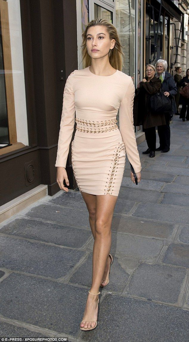 Pretty in pastels: Hailey Baldwin made the most of her long legs in a bodycon dress with safety pin detailing as she stormed the streets of Paris during PFW