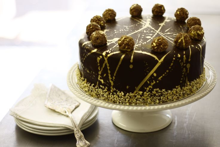 Ferrero Rocher Cake R260 12 Slices A Chocolate and Hazelnut Sponge, layered with a Moca Wafer and Hazelnut Filling, decorated with Ferrero Rocher Chocolate, covered with a Picasso Ganache.