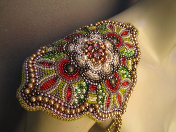 Single epaulet with genuine Swarovski crystals and pearls and extremely detailed glass bead embroidery. This piece is OOAK, please note, that it is to