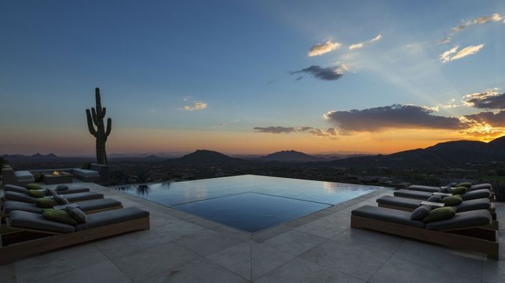 Interior Exquisite Arizona Desert Mountain Retreat With Comforting Views: Wonderful Scene In Outdoor Swimming Pool With One Big Rectangle Shape Of Outdoor Swimming Pool With Bedpool Also Chusions In Different Colour