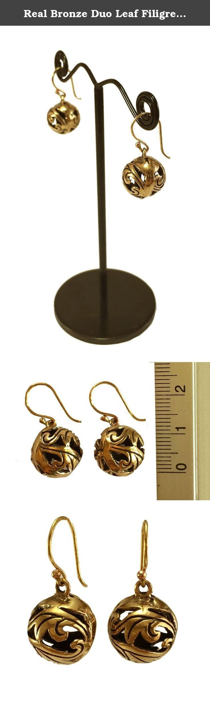 Real Bronze Duo Leaf Filigree Ball Drop Dangle Earrings Fish Hook Bronze Jewelry Gifts. -Good quality Bronze. -100% Satisfaction Guarantee. -Delivery Lead times: 14-21 days -Actual color may be vary from the pictures due to lighting or monitor.