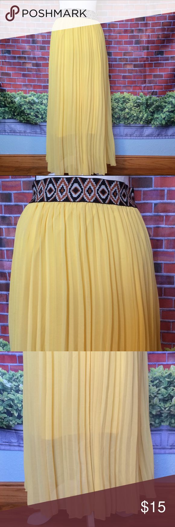 Magic - Beautiful bright yellow pleated maxi skirt Magic - Beautiful bright yellow pleated maxi skirt. Waist band has an Aztec style print. Partly lined. Open to reasonable offers. Magic Skirts Maxi
