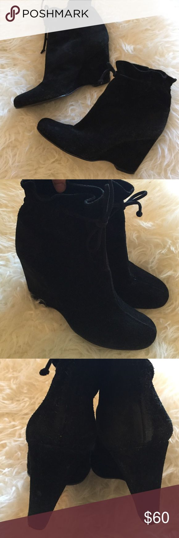 Kate Spade Black Suede Wedge Boots EUC authentic Kate Spade boots.  Note there are a few spots where the leather has worn down around the heels and back of the wedge as pictured.  Not very noticeable since the shoes are black. kate spade Shoes Heeled Boots