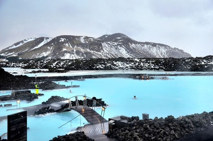 Iceland's Blue Lagoon is a luxurious swimming and spa location. Heated by geothermal energy, these pools steam majestically with the backdrop of mountains, and provide healing mud and water for many skin conditions.