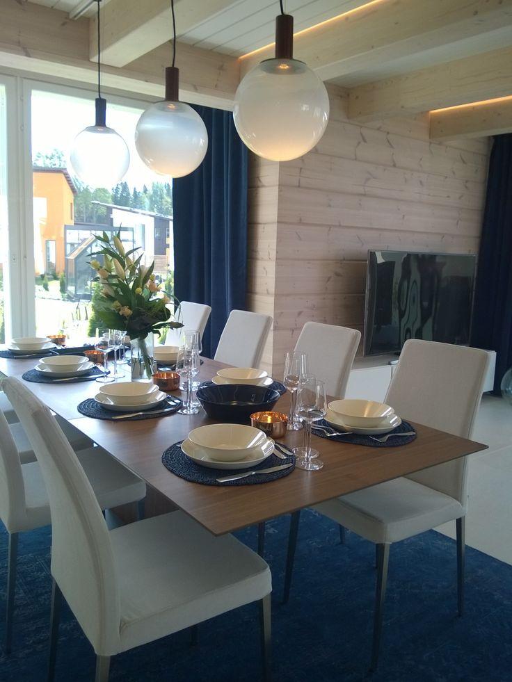 Villa Kapee dining room at Finnish Housing Fair 2015. Dark blue, walnut and light beige with copper. Designed by Hanna-Marie Naukkarinen