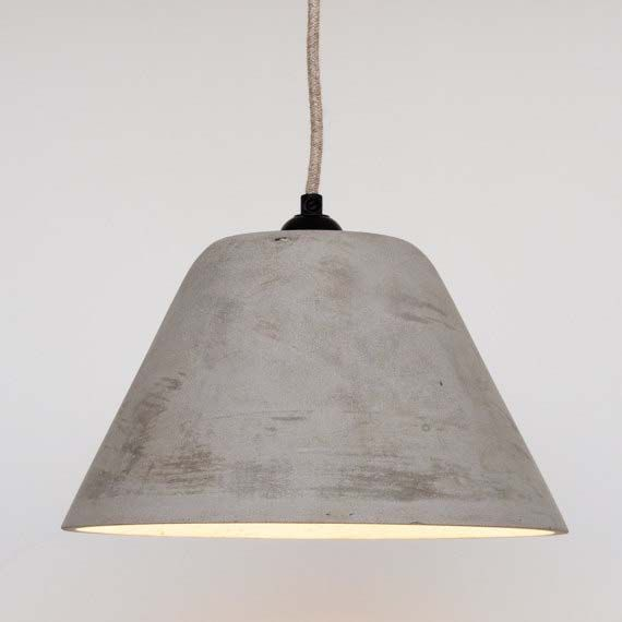 The conical concrete pendant lampshade is available on Etsy. This stunning industrial style concrete pendant is handmade at the Tim Walker Studio and is individually cast with fibreglass matting to provide extra strength.