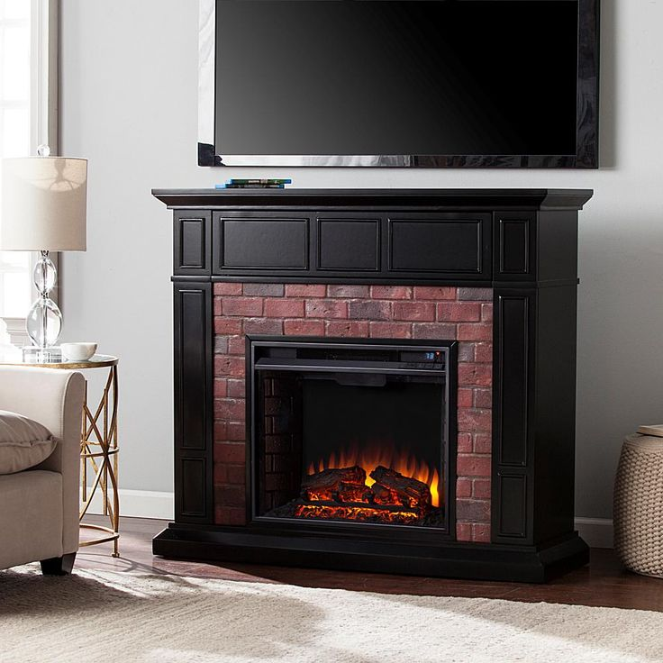 Home Marketplace Southern Enterprises Kyledale Faux Brick Electric Media Fireplace - Black with Red Rub Through and Simulated Red Brick