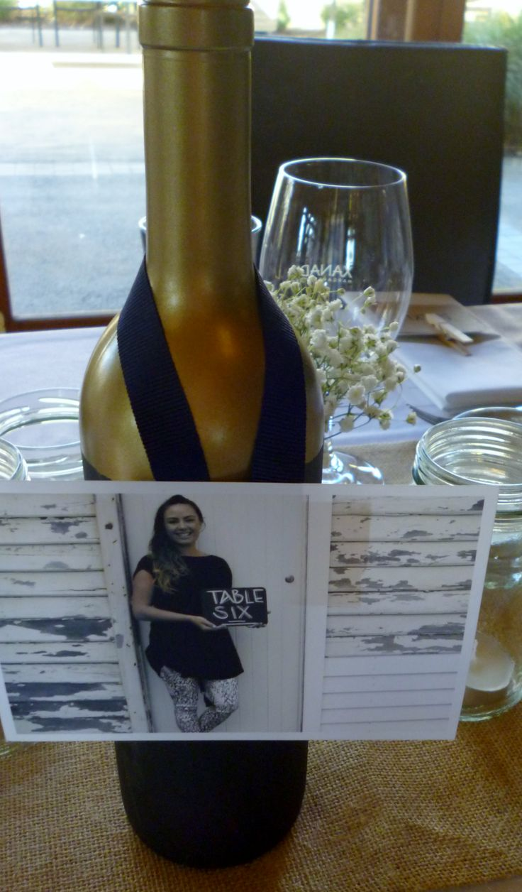 Gold & Chalkboard Wine Bottles for table numbers.Hire from www.capeoflove.com
