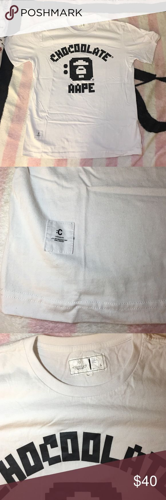 AAPE X CHOCOLATE HK WHITE T SHIRT SIZE L AAPE X CHOCOLATE HK WHITE T SHIRT SIZE L. Don't need it anymore since it's from my ex boyfriend. He wears as a Large size but I usually wear it as a oversized top. Don't know authenticity since it's his stuff but I uploaded more detail pics for you. It looks real to me. The quality & the touch. Anyways, don't need his stuff anymore. Pls take it home. Many life left. aape Shirts Tees - Short Sleeve