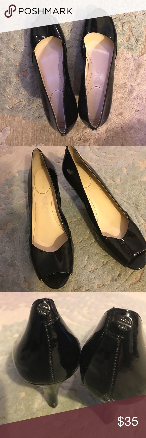 Calvin Klein pumps Black patent leather, open toe. Size 8. Heel and bottoms in great condition. Worn once on carpet. Calvin Klein Shoes Flats & Loafers