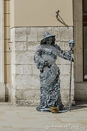 Floriańska street in old town of Krakow . Artist dressed in costume earn money from tourists . Poland , Europe.