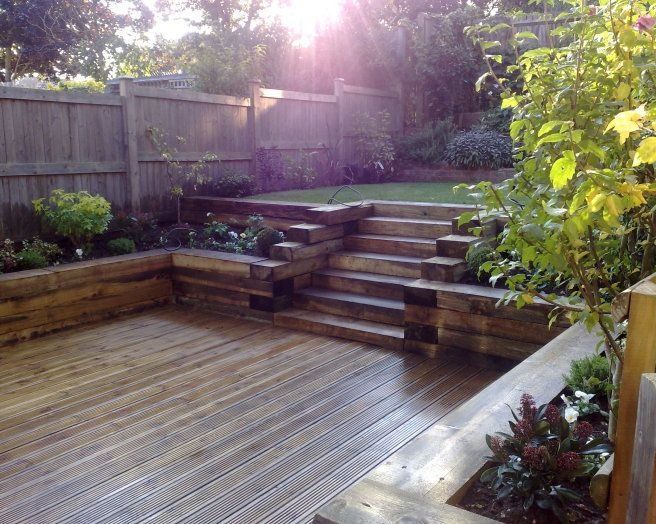 Photo Of Split Level Garden And Decking Railway Sleepers Raised Borders