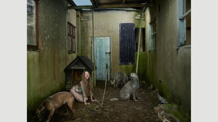Oxana Malaya, a neglected child raised by dogs, Ukraine, 1991. Staged Photography to tells a story (Credit: Julia Fullerton-Batten)