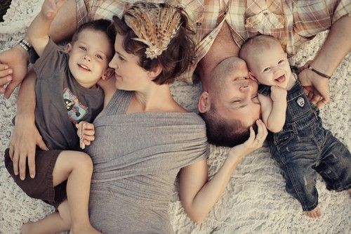 Cardigan Empire: Ten Exemplary Family Photo Wardrobes - I love this pose, laying down, picture taken from above.
