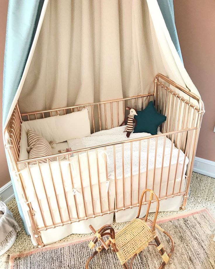 Walking into @denise_bosley_interiors 's Nursery for the #pasadenashowcase House makes me almost want to have another baby. Haha- Just kidding...that ship has SAILED! But really the rose gold crib and the vintage rattan rocking horse...an eclectic nursery mixing new boutique purchases with vintage finds.  It's a new baby and mama's dream! And if you think this is amazing you should see the puppet theatre...