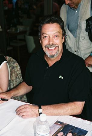 tim curry - signing and smiling