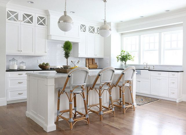 White Glass Subway tile in white kitchen. Looks clean and inviting!! https://www.subwaytileoutlet.com/products/White-Glass-Subway-Tile.html#.VZwyTPlViko