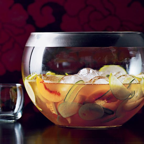 Gin, Carpano Antica Formula, elderflower liqueur, peach liqueur, lemon syrup, apple juice, tonic water, sliced cucumber and fruit // More Refreshing Party Punches: http://www.foodandwine.com/slideshows/party-punches #foodandwine
