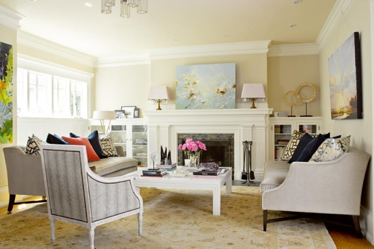 Sophisticated living room design with a beautiful white fireplace. 1 of 19 projects by Graciela Rutkowsi Interiors.