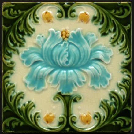 Art Nouveau floral Majolica tile (with Victorian floral attributes in the surrounding leaves as they have a slightly rococo feel), circa 1900.