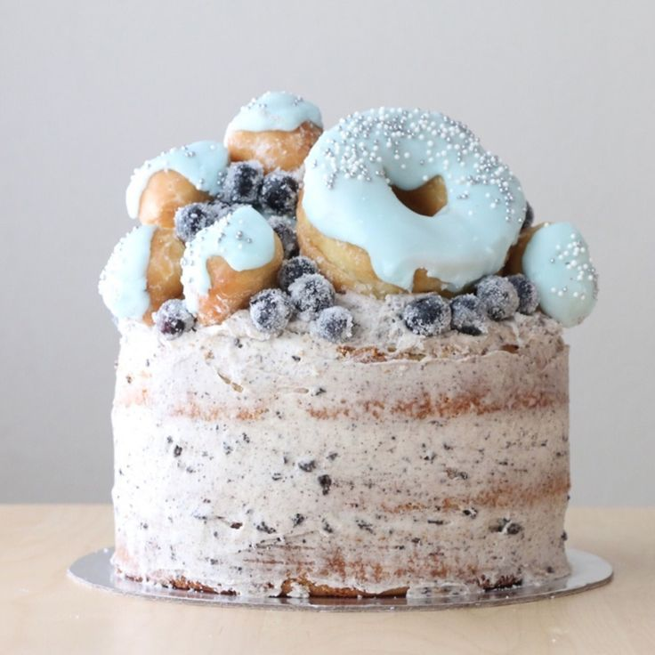 25. If you can't choose between a cake and donuts, then choose both! This nearly naked cake from Maple and Love is making us drool with it's frosted blueberry and donut topper, I mean, what's not to love here?
