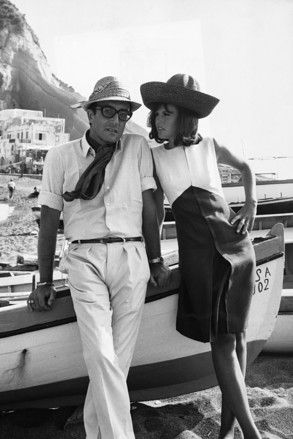 British comedian Peter Sellers with actress Britt Ekland on location in Italy in the 1960s.