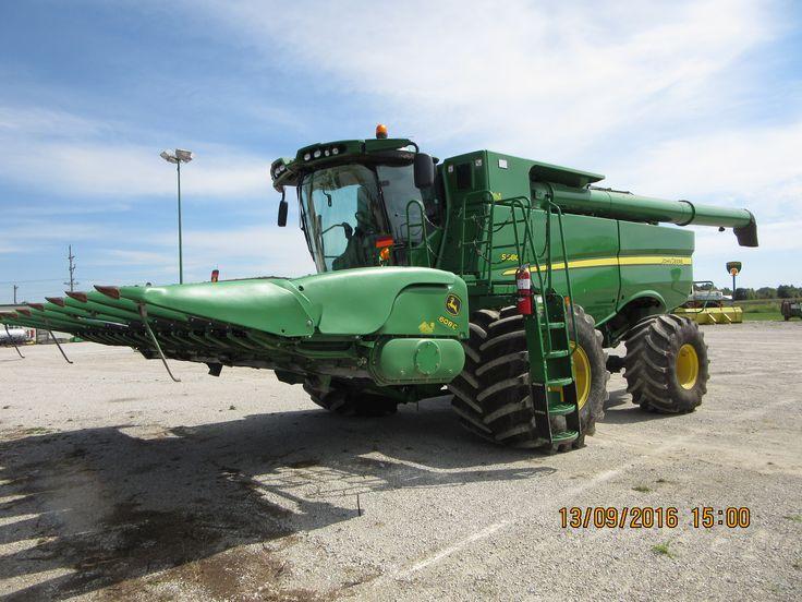 400 bushel John Deere S680 equipped with 8 row 608C corn head