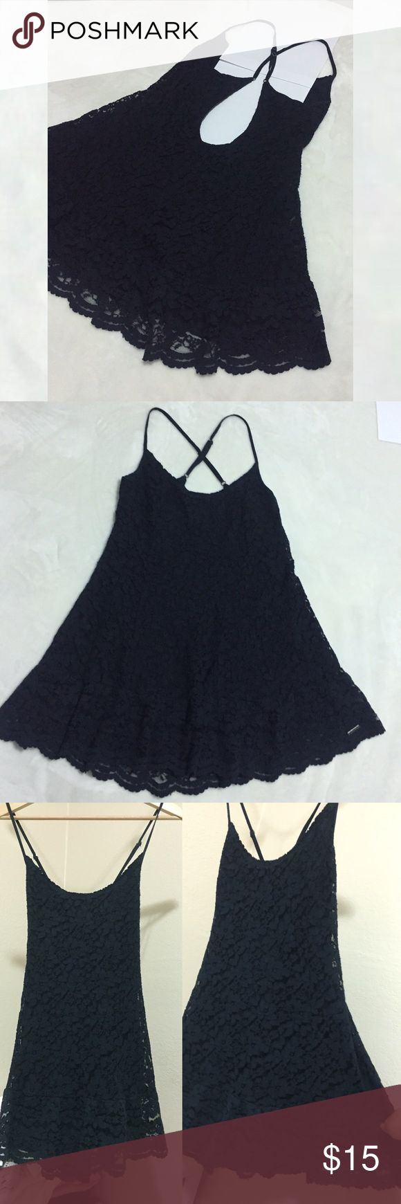 Abercrombie and Fitch lace dress Navy blue Abercrombie and Fitch flowy dress with back cutout. Has adjustable straps with the logo (3rd picture) as well as the logo at the bottom of dress. Such a cute dress you could dress it up or down if you'd like. Wore it a couple times. Feel free to make an offer or bundle to save. No trades sorry Abercrombie & Fitch Dresses Midi
