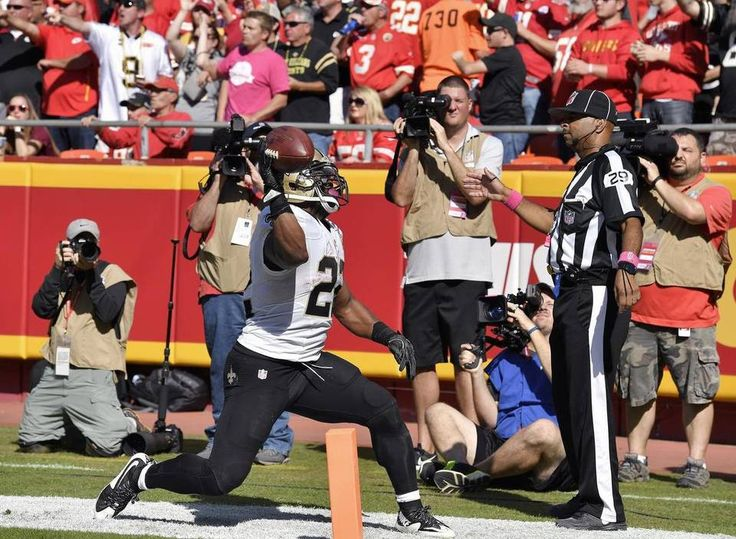 Saints vs. Chiefs  -  27-21, Chiefs  -  October 23, 2016:   New Orleans Saints running back Mark Ingram throws the football into the end zone pads after scoring in the third quarter during Sunday's football game against the Kansas City Chiefs on October 23, 2016 at Arrowhead Stadium in Kansas City, Mo.