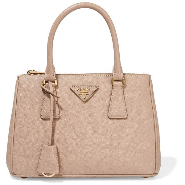 Prada Galleria mini textured-leather tote ($2,015) ❤ liked on Polyvore featuring bags, handbags, tote bags, tote handbags, beige tote handbags, prada tote bag, beige purse and prada tote